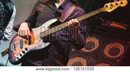 Rock Music, Bass Guitar Player On A Stage