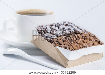 Chocolate Cake With Coffee Beans In The Background Cup Of Coffee