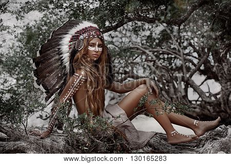 Indian woman hunter. Attractive tribal girl outdoors