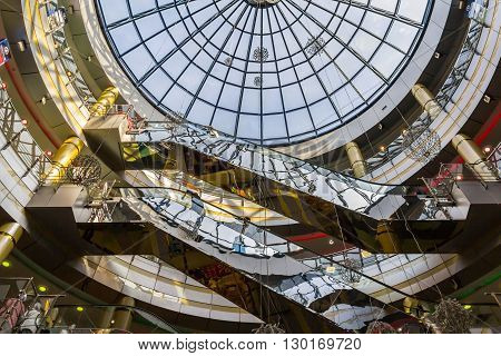 Kazan Russia - June 11 2015: Escalators under stained glass windows in megamall in the Kazan's business center