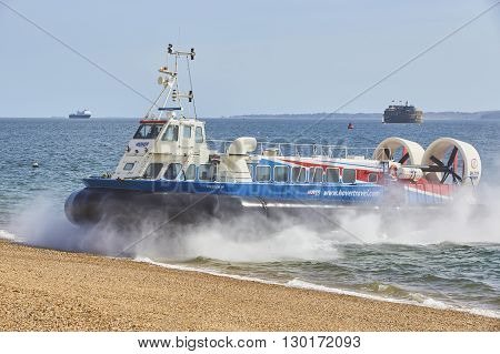 PORTSMOUTH UK, MAY 3 2016, Hovercraft arriving at Portsmouth. The Portsmouth Ryde hovercraft provides the fastest Isle of Wight ferry service across the Solent and is the world's longest running and only commercial hovercraft operator in Europe.
