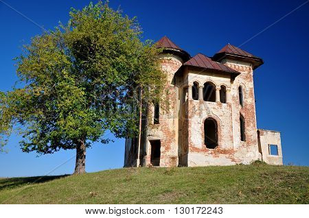 Old abandonned romanian rural castle in the middle of the field