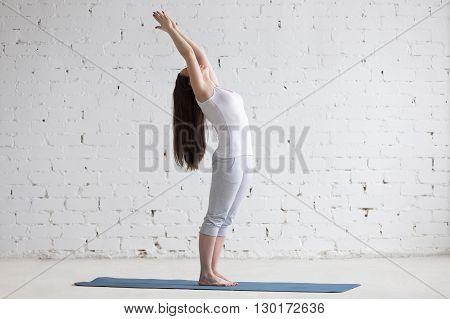 Beautiful Sporty Young Woman Doing Standing Backbend Pose In White Loft