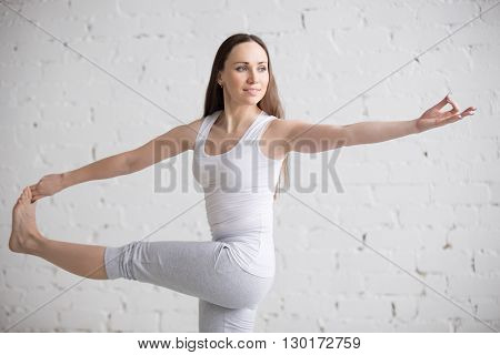 Portrait Of Happy Woman Doing Parivrtta Utthita Hasta Padangustasana Pose