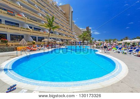 TAURITO, GRAN CANARIA, SPAIN - APRIL 20, 2016: Sun holidays at the pool of Paradise Lago Taurito hotel, Gran Canaria. Paradise is a complex of 4 hotels in Gran Canaria.