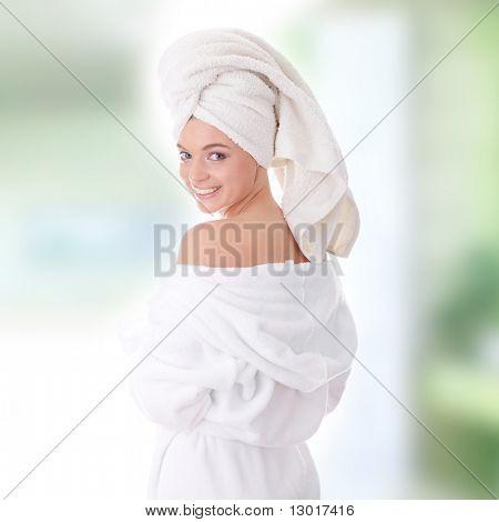 Young beautiful caucasian woman after bath