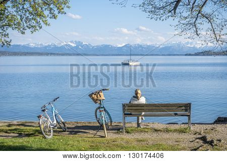 An image of a woman having a rest at Starnberg lake