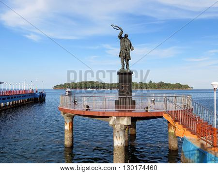 Port Blair-Apr 21: Statue of Late Rajiv Gandhi (Youngest Indian Prime Minister from 1984 to 1989) at water sports complex with Ross Island in background, Port Blair Apr 21, 2012 in Andaman and Nicobar Islands, India, Asia.