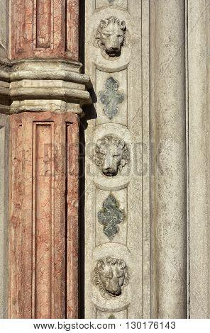 Detail of three saint mark lions decoration from Porta della Carta gothic portal in Saint Mark Square Venice