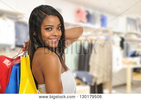 Beautiful young black woman shopping inside a mall
