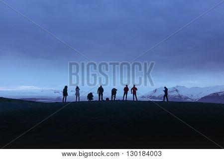 Photographers taking picture of glacier in Jokulsarlon lagoon