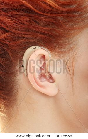 Redhead woman wearing hearing aid