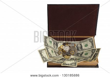 A variety of monetary denominations of coins on the paper in an open casket: money to money cling (stick).