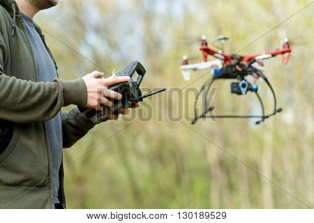 Man controling a drone.