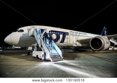 TOKYO JAPAN - FEBRUARY 27 2015. Passengers enters on board of Boeing 787 Dreamliner of LOT Polish Airlines on airport in Tokyo