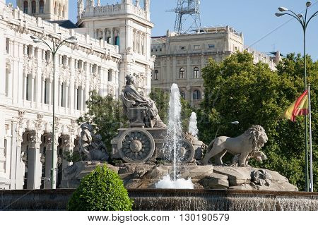 landmark of famous neoclassical sculpture monument fountain of greek goddess Cibeles and lions in Madrid city Spain Europe with water falling. Year 1782 by Ventura Rodriguez artist