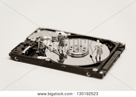 Women clean up a hard drive. Technology concept. Macro photo.