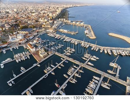 Aerial view of the beautiful Marina in Limassol city in Cyprus the beach boats piers villas commercial area old port (palio limani) and Molos. A very modern high end and newly developed space where yachts are moored and it's perfect for a waterfront prome