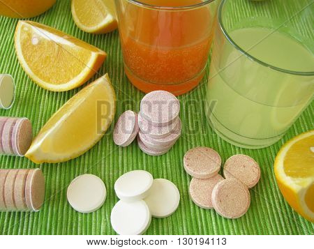 Lemonade tablets with vitamins in drinking glasses