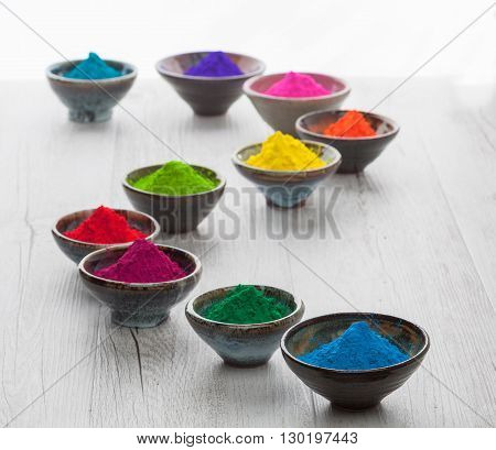 Colorful Holi Powder In Cups Arranged In A Snake Shape