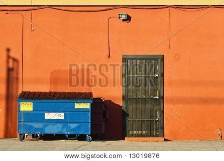 Blue Dumpster & Orange Wall