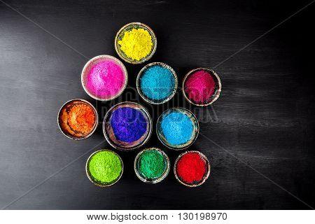 Holi Powder On Grungy Chalkboard