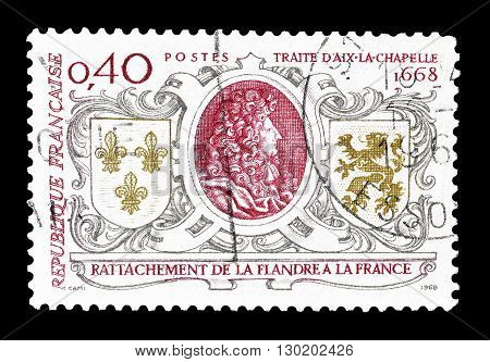 FRANCE - CIRCA 1968 : Cancelled postage stamp printed by France, that shows  Louis XIV, Arms of France and Flanders.