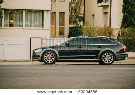 STRASBOURG FRANCE - MARCH 18 2016: AUDI wagon car parked in front of luxury house