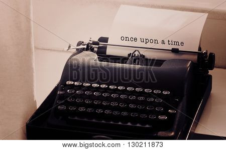 Once upon a time message on a white background against typewriter on a table