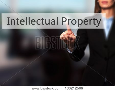 Intellectual Property - Businesswoman Hand Pressing Button On Touch Screen Interface.