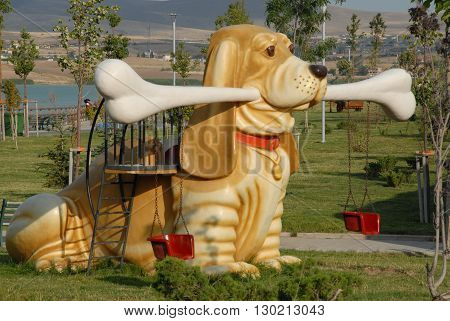 ANKARA/TURKEY-JULY 20, 2008: Swing with dog maquette at the Mogan Lake for childeren. July 20, 2008-Ankara/Turkey
