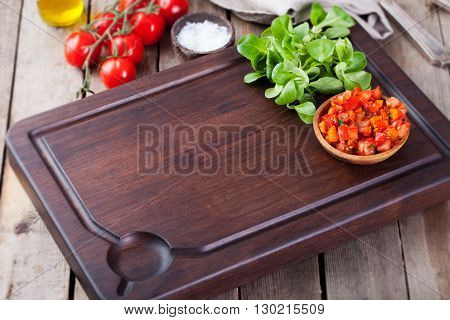 Salsa sauce and ingredients with fresh salad Dark steak cutting bord wooden background Copy space