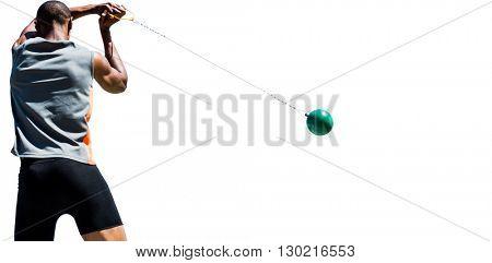 Rear view of sportsman practising hammer throw