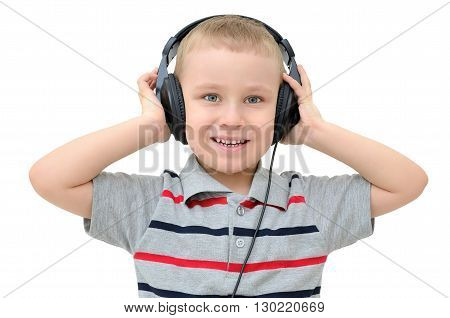 Little boy listening to headphones on a white background