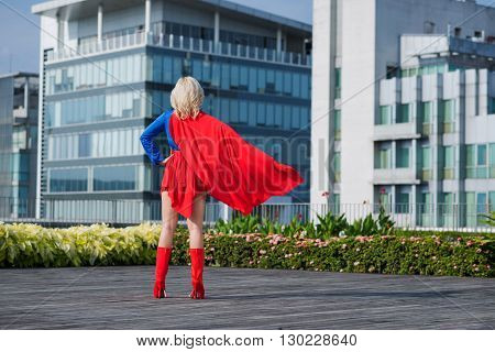 Rear view of superwoman looking at the city