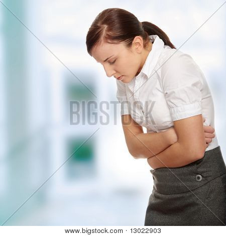 Business woman with stomach issues