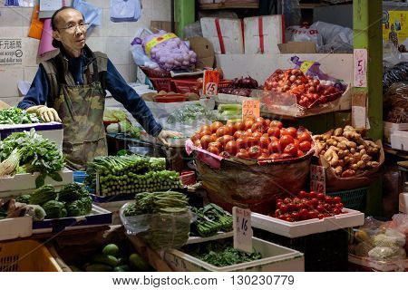 Hong Kong, China - 19 April 2016: asian man selling vegitables on traditional market