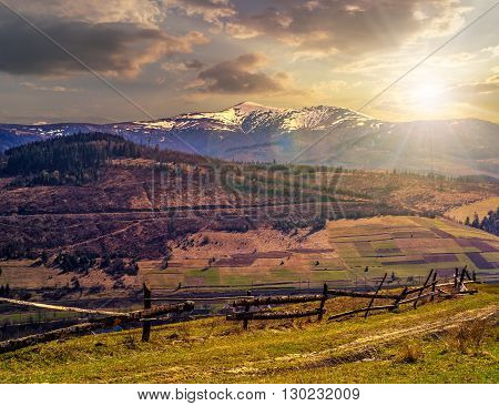Rural Area With Snowy Mountain Tops At Sunset