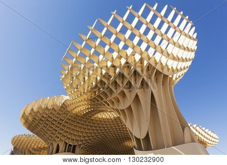 Seville, Spain - May 1, 2016: The Metropol Parasol at Plaza de la Encarnacion in Seville, designed by Juergen Mayer H. it is the largest wooden structure in the world.