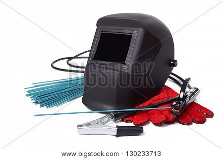 Welding equipment isolated on a white background, welding mask, leather gloves, welding electrodes, high-voltage wires with clips, set of accessories for arc welding. poster