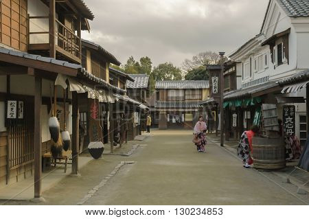 KYOTO, JP - JANUARY 21, 2012: Actors entertain visitors to the TOEI Kyoto Studio Park, a recreation of Edo period streets featuring a collection of traditional buildings which are used in the production of more than 200 films a year.