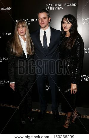 NEW YORK-JAN 5: (L-R) NBR President Annie Schulhof, Matt Damon and wife Luciana Damon attend the 2015 National Board of Review Gala at Cipriani 42nd Street on January 5, 2016 in New York City.