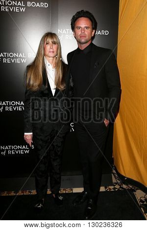 NEW YORK-JAN 5: NBR President Annie Schulhof (L) and Walton Goggins attend the 2015 National Board of Review Gala at Cipriani 42nd Street on January 5, 2016 in New York City.