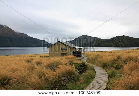 Scene in the Fjordland National Park New Zealand. Public hut. Green Lake tramping route.
