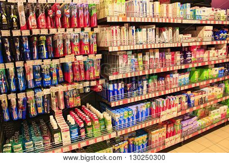 Chernihiv / Ukraine. 06 March 2016:different kinds of toothpaste and brushes and other hygiene products with wide assortment on the shelves of supermarket. 06 March 2016 in Chernihiv / Ukraine.
