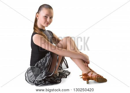 Girl in dress for ballroom dancing sitting.