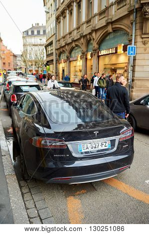 STRASBOURG FRANCE - MAY 14 2016: Beautiful Tesla Model S car parked in the center of the city - focus is on the car