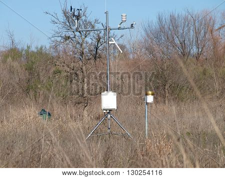 Outdoor weather station set-up in a field near the Dallas Autobahn Center.