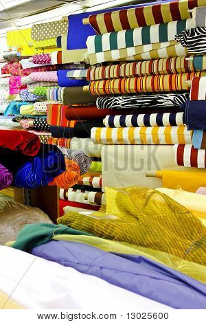 Textile fabric rolls for fashion clothing industry poster