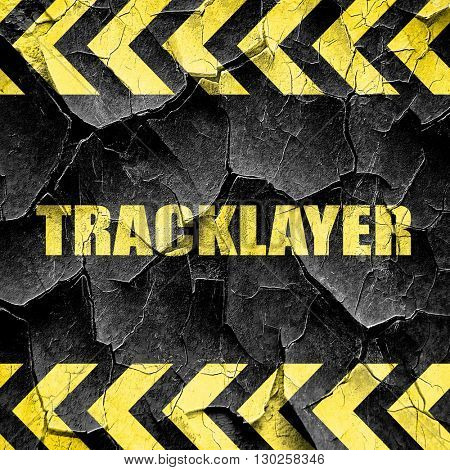 tracklayer, black and yellow rough hazard stripes